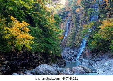 Silky waterfalls in a mysterious gorge with colorful autumn trees by the stream in Akita Prefecture Japan ~ Nature scenery of Japanese countryside with beautiful foliage in fall season (Long Exposure)