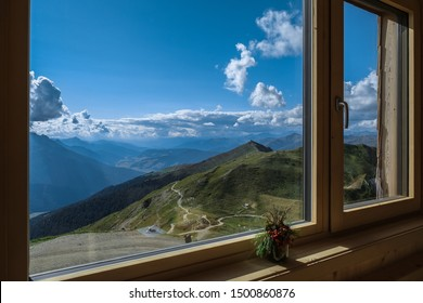 Sillianer refuge, Carnic Alps, South Tyrol, Austria-August 15, 2019: View of Monte Elmo/Helm mountain, Puster valley (in far background) & Sesto Dolomites in Italy, as seen through the refuge windows