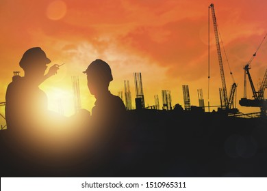 sillouette of engineer and building contractor group planning and survey space of construction