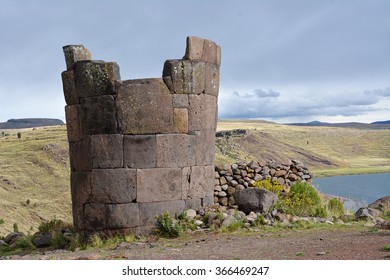 Sillustani tombs in the peruvian Andes near town Puno, Peru. An inca burial tower at the Sillustani archaeological site near town Puno, Peru.