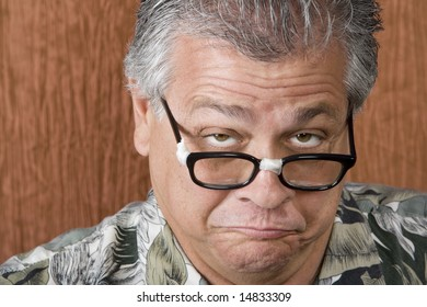 Silly Mexican-Italian Man with Taped Corrective Glasses