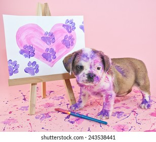 Silly puppy that made a mess painting a picture of a heart with paw prints going through it.