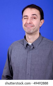 an silly young man portrait over a blue background
