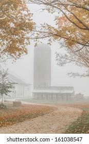 Silo on foggy morning in Ontario farmland
