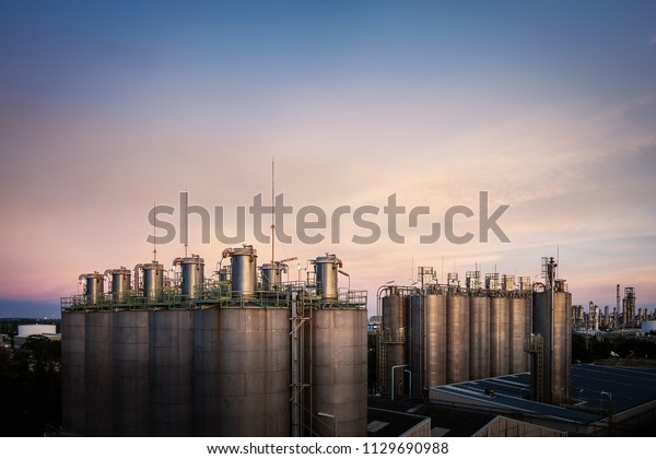 Silo storage  plastic resins for product loading in warehouse with twilight sky background