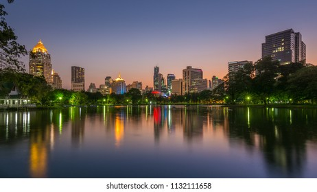Silom district night view reflection in water taken from Lumpini park, Bangkok, Thailand, March 14th 2016