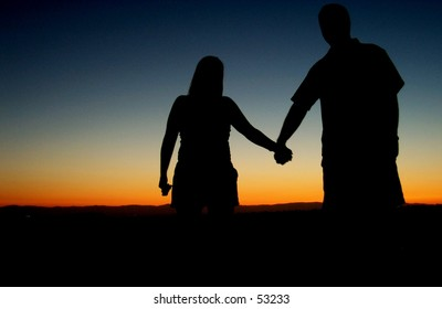 Silouette of a couple at sunset