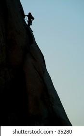 Silouhette of climber at Joshua Tree, CA