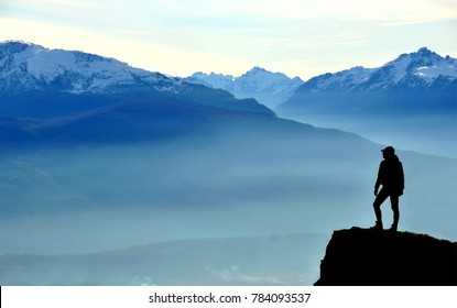 Siloutte of a person at the top of the mountain