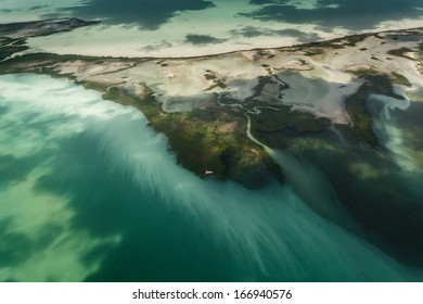 Silt and run off from island streak the ocean with pollution and threaten the fragile coral barrier reef ecosystem