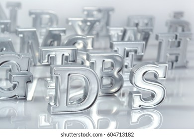 Silver alphabet letters close-up on a white background