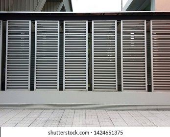 Silver aluminum louver on the wall for ventilation and lighting with horizontal pattern. Exterior design. Energy saving concept.