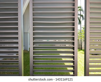Silver aluminum louver on the wall for ventilation and lighting with horizontal pattern. Exterior design, Energy saving concept.