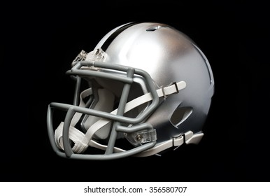 Silver american football helmet isolated on black background