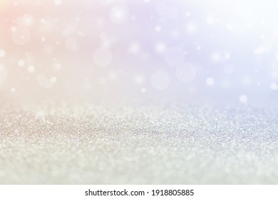 Silver background, bokeh with colored highlights.