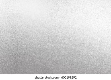 Silver background foil texture metal paper. White gold shiny wall shimmer glitter metallic card.