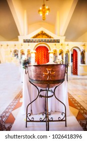 Silver bath for baptism ceremony inside church with decoration closeup
