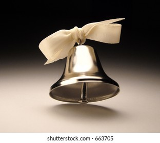 Silver bell with bow.