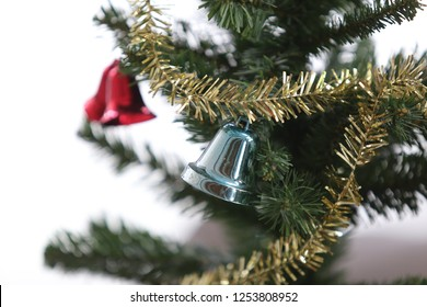 silver bell on christmas tree