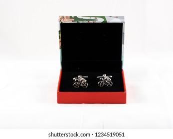 Silver bicycle cufflink
