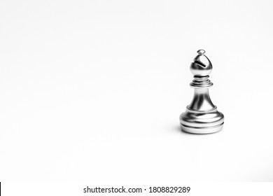 silver bishop chess standing alone on white background. - leadership concept.
