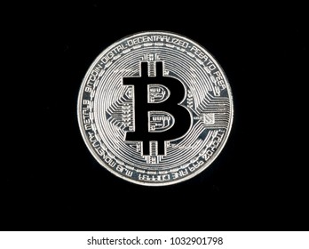 Silver bitcoin coin on black background, top view