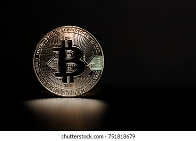 Silver bitcoin on black background