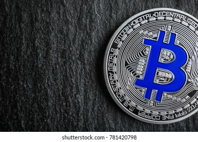 Silver bitcoin on dark background, closeup