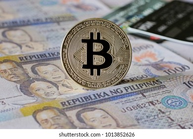 Silver Bitcoin on  Philippine Peso  Banknotes Background