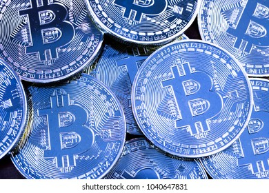 Silver Bitcoin pile background - Bitcoin mining business is the process of adding transaction records to Bitcoin public ledger of past transactions or blockchain. Cryptocurrency trading concept.