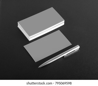 Business card background stock photos images photography silver blank business cards with pen on a black leather background colourmoves