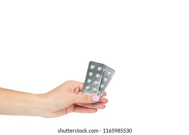Silver blister packs pills with hand isolated on white background, copy space template.
