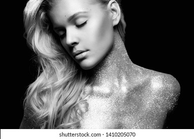 Silver Blond Girl. Beautiful Young Woman with Sparkles on her Body. Black and white portrait