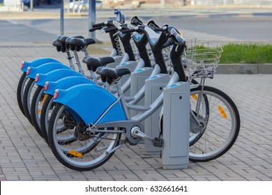 Silver blue bicycle at parking, bike rent