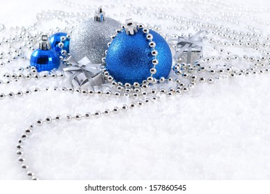 Silver and blue Christmas decorations on a white background