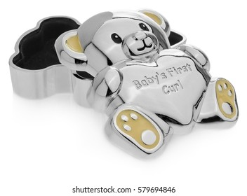 Silver box in the shape of a teddy bear to the first baby teeth. The Children souvenirs, lined inside with black velvet. Ears and feet in yellow on a white background with slight reflection.