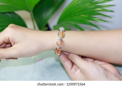 Silver bracelet with carnelian gemstone on female hand