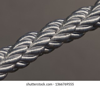 Silver Braided Rope on a grey background