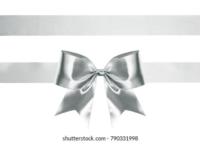 silver bright silk ribbon bow with horizontal ribbons isolated on white. holiday background