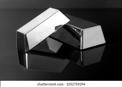 Silver bullion bars on black background