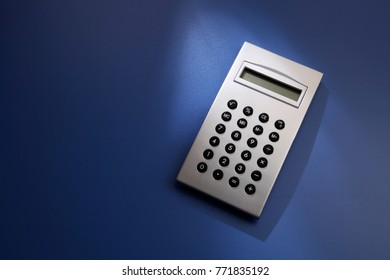 silver calculator on the blue background