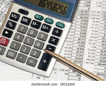 silver calculator with pen and calculations numbers on paper