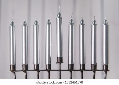 Silver candles of menorah. Close-up.