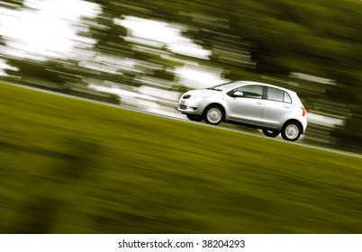 silver car on a countryside road