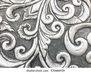 Silver carving art on the walls temple in Thailand.