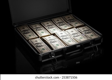 Silver case with money on black background