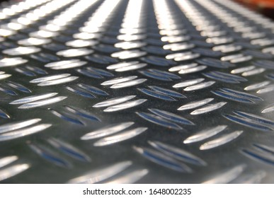 silver checker plate close up from angle perspective