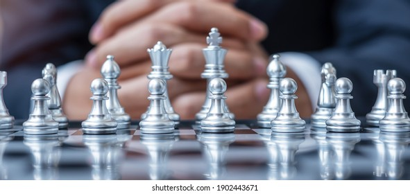 silver Chess figure team (King, Queen, Bishop, Knight, Rook and Pawn) with businessman manager background. Strategy, Success, management, business planning, tactic, thinking, vision and leader concept