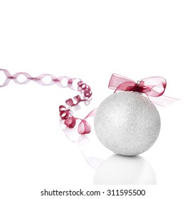 Silver Christmas ball with red bow. Copy space.