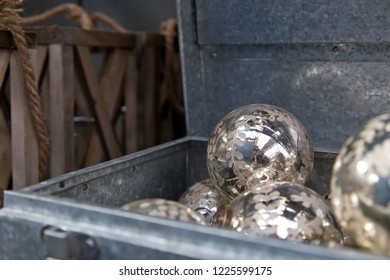 Silver Christmas balls in metal suitcase